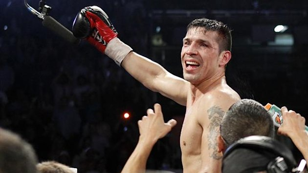 Sergio Martinez of Argentina celebrates his victory over WBC middleweight champion Julio Cesar Chavez Jr. of Mexico after their title fight at the Thomas & Mack Center in Las Vegas, Nevada