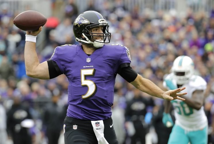 Joe Flacco and the Ravens had a big offensive game against the Dolphins (AP)
