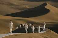 Models are seen on a catwalk during a Pierre Cardin fashion show in the desert of Whistling Sand Mountain on the outskirts of Dunhuang, China's northwest Gansu province, in 2007