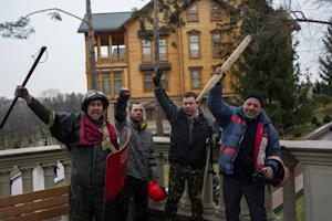 Protesters pose in front of the Ukrainian President…