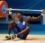 File photo shows Daniel Koum at the Commonwealth Games in Melbourne in 2006. The Australian Weightlifting Federation chief claimed Koum, 26, asked for the money at the Oceania Weightlifting Championships in Samoa last week