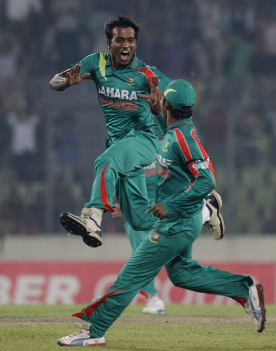 Bangladesh's Hossain celebrates with a teammate as he dismissed New Zealand's McCullum successfully during their first one-day international cricket match in Dhaka