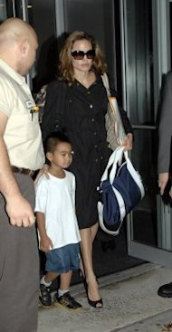 Angelina Jolie picks up her son, Maddox, at school. (Photo by Arnaldo Magnani/Getty Images)