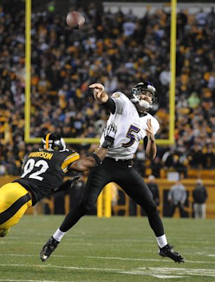 Joe Flacco was efficient against the Steelers on Saturday night. (AP)