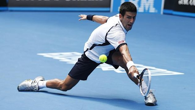 Novak Djokovic of Serbia hits a return to Radek Stepanek of Czech Republic during their men's singles match at the Australian Open