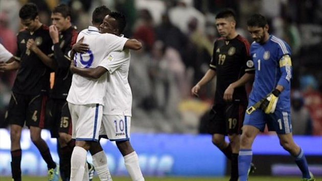 Luis Fernando Garrido (19) and Marvin Chavez (10) of Honduras celebrate victory over Mexico (Reuters)