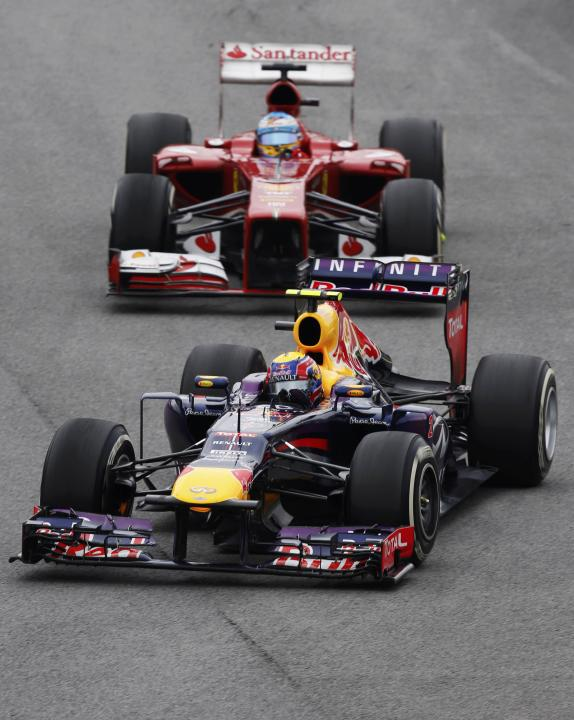Mark Webber of Australia drives ahead of Fernando Alonso of Spain during the Brazilian F1 Grand Prix at the Interlagos circuit in Sao Paulo