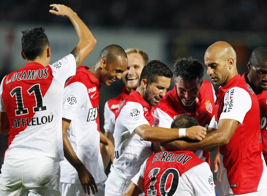 Monaco's Dimitar Berbatov celebrates after scoring against Girondins Bordeaux during their French Ligue 1 soccer match in Bordeaux