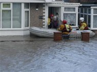 Emergency services rescue people from a flooded properties in Rhyl, north Wales December 5, 2013. REUTERS/Phil Noble