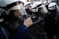 Bahraini riot police, including women, take position during an anti-government protest in the capital Manama on September 7. While the 21st session of the Human Rights Council in Geneva saw several countries including China, Saudi Arabia, Thailand and Yemen applaud Bahrain for its moves so far on human rights, the United States was less forthcoming