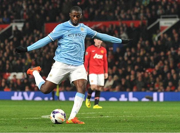 Manchester City's Ivorian defender Yaya Toure shoots to score at Old Trafford in Manchester on March 25, 2014