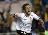Valencia's midfielder Jordi Alba celebrates after scoring during the UEFA Europa League quarter-final second leg football match between Valencia and AZ Alkmaar on April 5, 2012 at the Mestalla stadium in Valencia. AFP PHOTO/ Jaime REINA