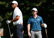 American Tiger Woods (L) and Rory McIlroy of Northern Ireland are pictured during a September 2012 tournament. Woods easily accounted for McIlroy in the first ever matchplay showdown between the pair to reach the semi-finals at the World Golf Final in Belek, Turkey
