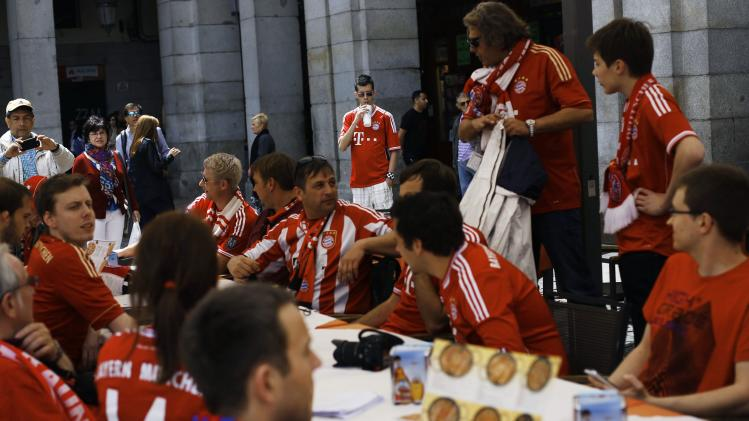Bayern Munich supporters wait to order at a terrace in central Madrid