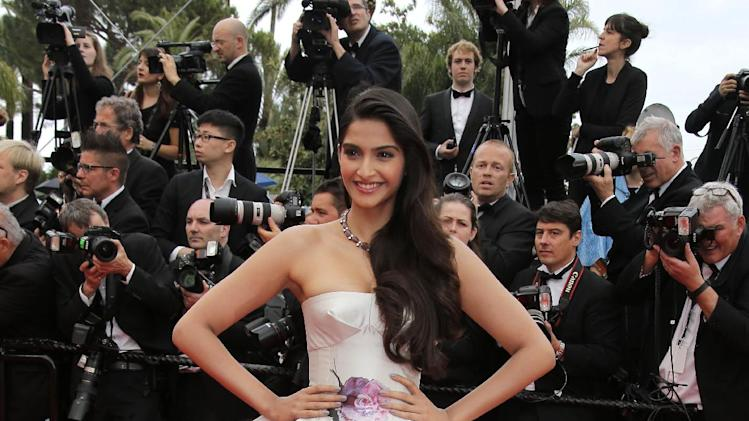 Actor Sonam Kapoor arrives for the screening of the film Young & Beautiful at the 66th international film festival, in Cannes, southern France, Thursday, May 16, 2013. (AP Photo/Lionel Cironneau)