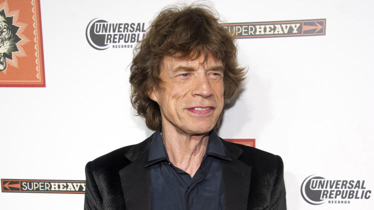 "FILE - In this Sept. 21, 2011 file photo, SuperHeavy member Mick Jagger attends the release party for the band's new CD, ""SuperHeavy"", in New York. Jagger will host the ""Saturday Night Live"" finale on May 19. (AP Photo/Charles Sykes, file)"
