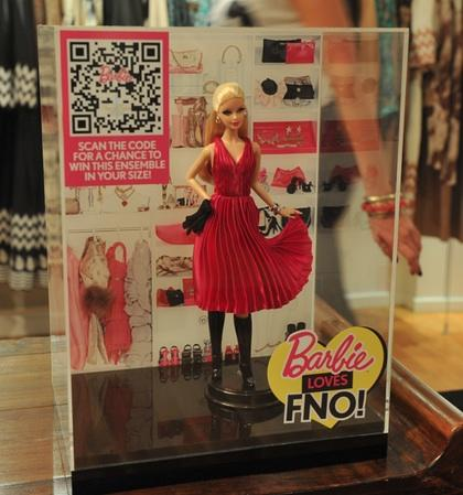 The Barbie Loves Fashion's Night out Tracy Reese doll wears a miniature designer outfit