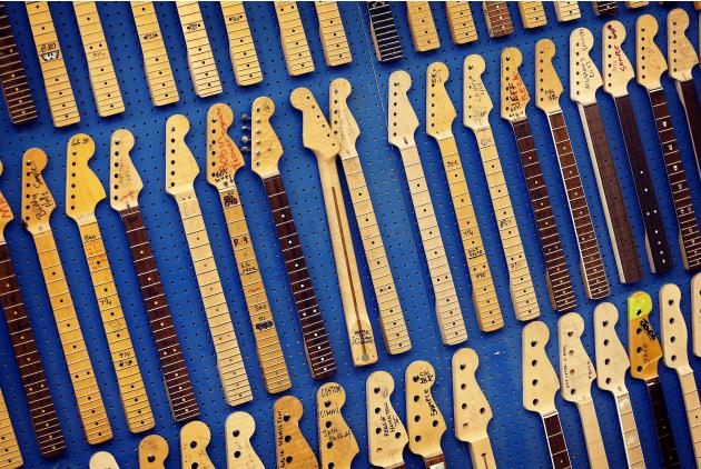 This Tuesday, Oct. 15, 2013 photo shows Fender Stratocaster electric guitar neck templates at the Fender factory in Corona, Calif. Celebrating 60 years in 2014, countless musicians continue to use the
