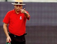 Umpire Nadir Shah gives a dismissal during a one-day match between Bangladesh and New Zealand at The Sher-e-Bangla National Cricket Stadium in Dhaka, on October 9, 2008. The Bangladesh Cricket Board has banned Shah for 10 years after a sting operation by an Indian television channel found him willing to fix matches for cash