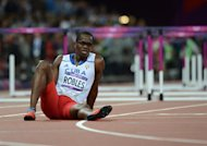 Cuba's Dayron Robles reacts after suffering an injury during the men's 110m hurdles final at the athletics event of the London 2012 Olympic Games on August 8, 2012 in London. AFP PHOTO / OLIVIER MORIN