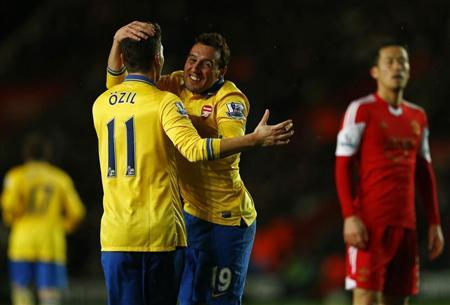 Arsenal's Cazorla celebrates his goal with teammate Ozil after scoring against Southampton during their English Premier League soccer match in Southampton, southern England