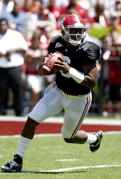 Alabama quarterback Blake Sims rolls out to pass during the A-Day NCAA college football spring game Saturday, April 19, 2014, in Tuscaloosa, Ala
