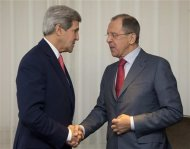 U.S. Secretary of State John Kerry (L) and Russia's Foreign Minister Sergei Lavrov shake hands during a photo opportunity prior to their meeting, in Geneva November 23, 2013. REUTERS/Carolyn Kaster/Pool