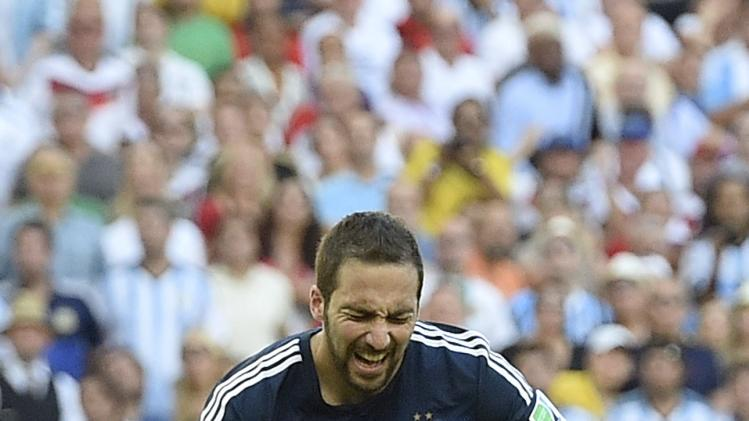 Gonzalo Higuain reacts after missing a chance during the World