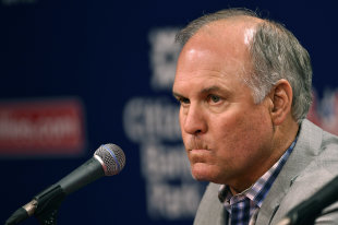Ryne Sandberg pauses during a news conference where he announced his resignation Friday. (AP)