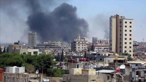 An image grab taken from a video released by the United Nations Supervision Mission in Syria (UNSMIS) shows smoke rising following shelling from the central flashpoint city of Homs on June 11.