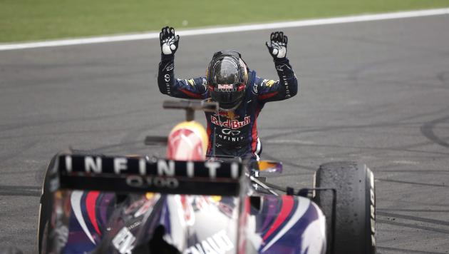 Red Bull Formula One driver Vettel bows down in front of his car after winning the Indian F1 Grand Prix at the Buddh International Circuit in Greater Noida