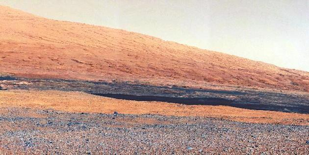 In this image released by NASA on Monday, Aug. 27, 2012, a photo taken by the Mast Camera (MastCam) highlights the geology of Mount Sharp, a mountain inside Gale Crater, where the rover landed. Prior
