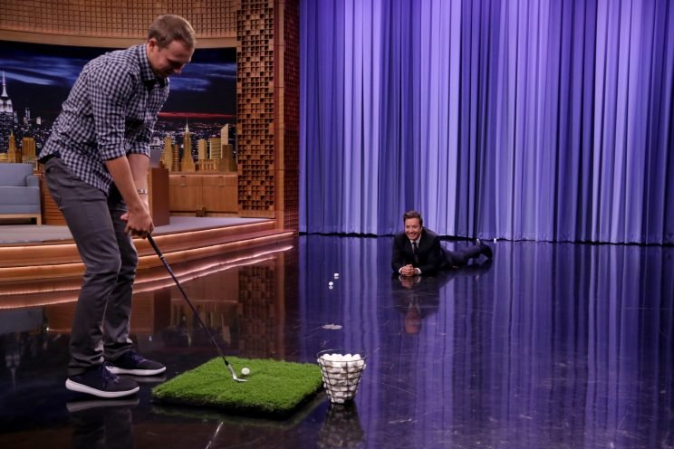 Jordan Spieth tried getting marshmallows in Jimmy Fallon's mouth. (Getty Images)