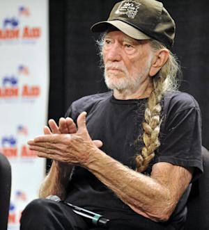 Willie Nelson attends a news conference prior to the start of the Farm Aid 2013 concert at Saratoga Performing Arts Center in Saratoga Springs, N.Y., Saturday, Sept. 21, 2013. (AP Photo/Hans Pennink)