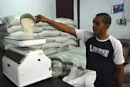 A Cuban salesman weighs rice in a shop in Havana in 2008. Japan has donated about $3 million worth of machinery to grow and harvest rice as Cuba seeks to halve imports of the grain which top $200 million per year, local media said Tuesday