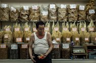 Image taken on September 5, 2012 shows a man working at a store selling shark fins in Hong Kong. Humans kill about 100 million sharks each year, mostly for their fins, according to the UN Food and Agriculture Organisation