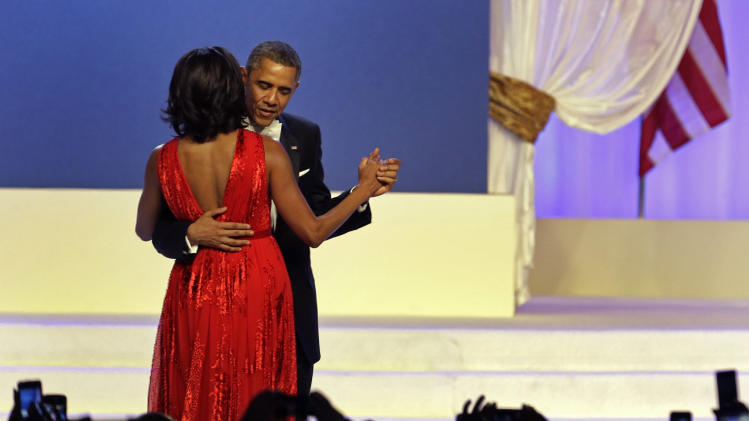 President Barack Obama and first lady Michelle Obama dance during The Inaugural Ball at the Washignton convention center during the 57th Presidential Inauguration in Washington, Monday, Jan. 21, 2013. (AP Photo/Paul Sancya)