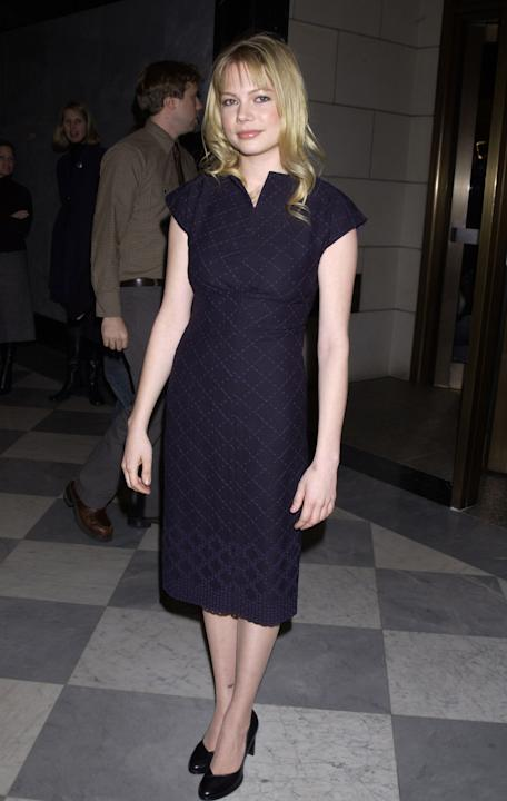 Michelle Williams in a navy sheath