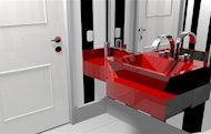 A red counter and sink give this small bathroom a daring appeal.