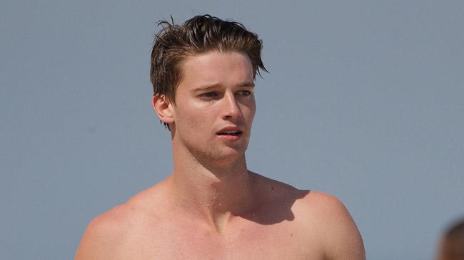 Patrick Schwarzenegger gets rowdy with his friends on Miami Beach during a game of catch