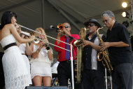 CORRECTS SPELLING OF FIRST NAME TO ALLEN INSTEAD OF ALLAN - Allen Toussaint's horn section performs at the New Orleans Jazz and Heritage Festival in New Orleans, Saturday, May 5, 2012. (AP Photo/Gerald Herbert)