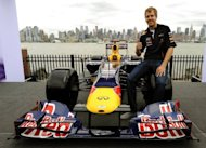 Formula One world champion Sebastian Vettel poses on a Red Bull F1 car on June 11. Vettel reacted coolly on Thursday amid speculation that he might move to join Fernando Alonso at Ferrari in an F1 'super-team' in 2014