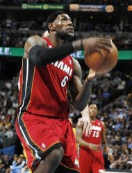 Miami Heat forward LeBron James drives the lane for a shot against the Denver Nuggets in the first quarter of an NBA basketball game in Denver on Thursday, Nov. 15, 2012. (AP Photo/David Zalubowski)