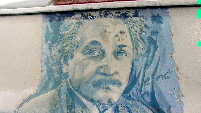 "Portrait of Albert Einstein.  A paw print is visible on Einstein's forehead, courtesy of the artist's pet cat. ""I had walked out one morning to finish this piece, and found Squeek had beat me to it,"" said Scott Wade. ""Now, if a cat can do it, what are you waiting for? Dirty Car Art is for everyone."""
