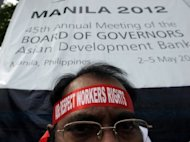 A protester outside an Asian Development Bank meeting in Manila earlier this month. Philippine President Benigno Aquino has failed to deliver on campaign pledges to prosecute members of the security forces implicated in killings and disappearances, Human Rights Watch says