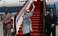 US Secretary of State Hillary Clinton boards a plane in Beijing to head to Bangladesh on May 5. Clinton landed in India on Sunday with hopes of reinvigorating a relationship seen as losing steam despite efforts to bring the world's two largest democracies closer