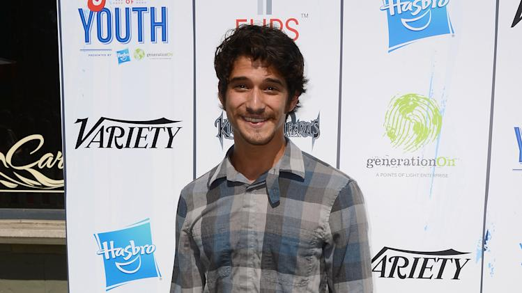 "Tyler Posey arrives at the 7th Annual ""Power of Youth"" event on the Universal back lot on Saturday, July 27, 2013 in Universal City, Calif. (Photo by Jordan Strauss/Invision/AP)"