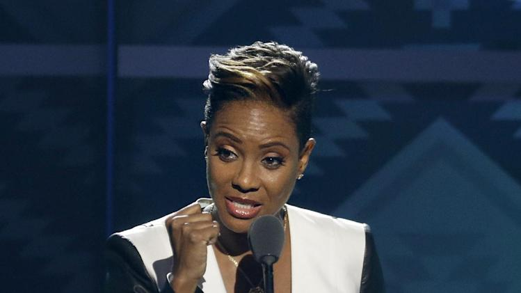 "Rapper MC Lyte accepts the ""I Am Hip Hop Award"" during the BET Hip Hop Awards, Saturday, Sept. 28, 2013, in Atlanta. (AP Photo/David Goldman)"