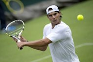 Spanish tennis superstar Rafael Nadal, pictured in June 2012, out of action since June, will resume training in two weeks with the aim of playing in the ATP Tour Finals and the Davis Cup final, his uncle has told Fox Sports television channel