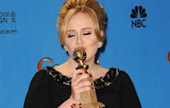 Adele... scooping her Golden Globe for Skyfall (Copyright: Rex)